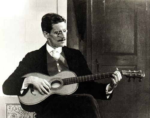 James Joyce playing guitar